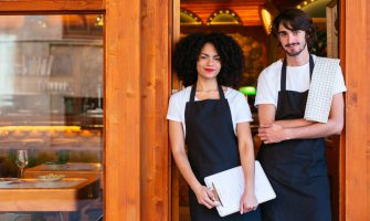portrait of waiters in front of restaurant - sexual harassment training