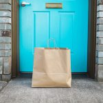 Shopping Bag In Front Of Apartment Door