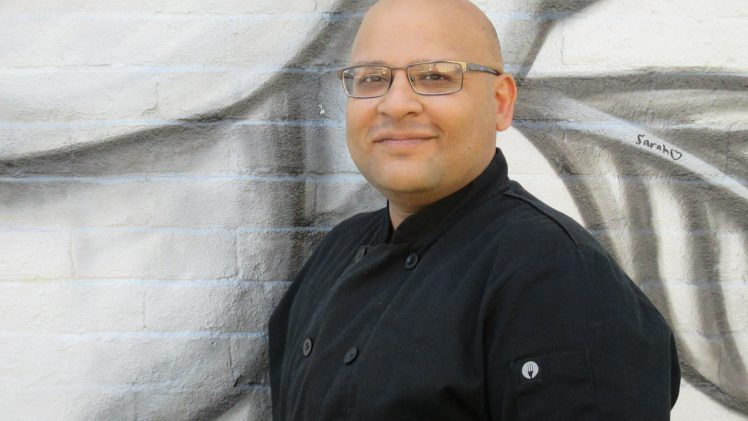 zia shiekh posing in front of mural