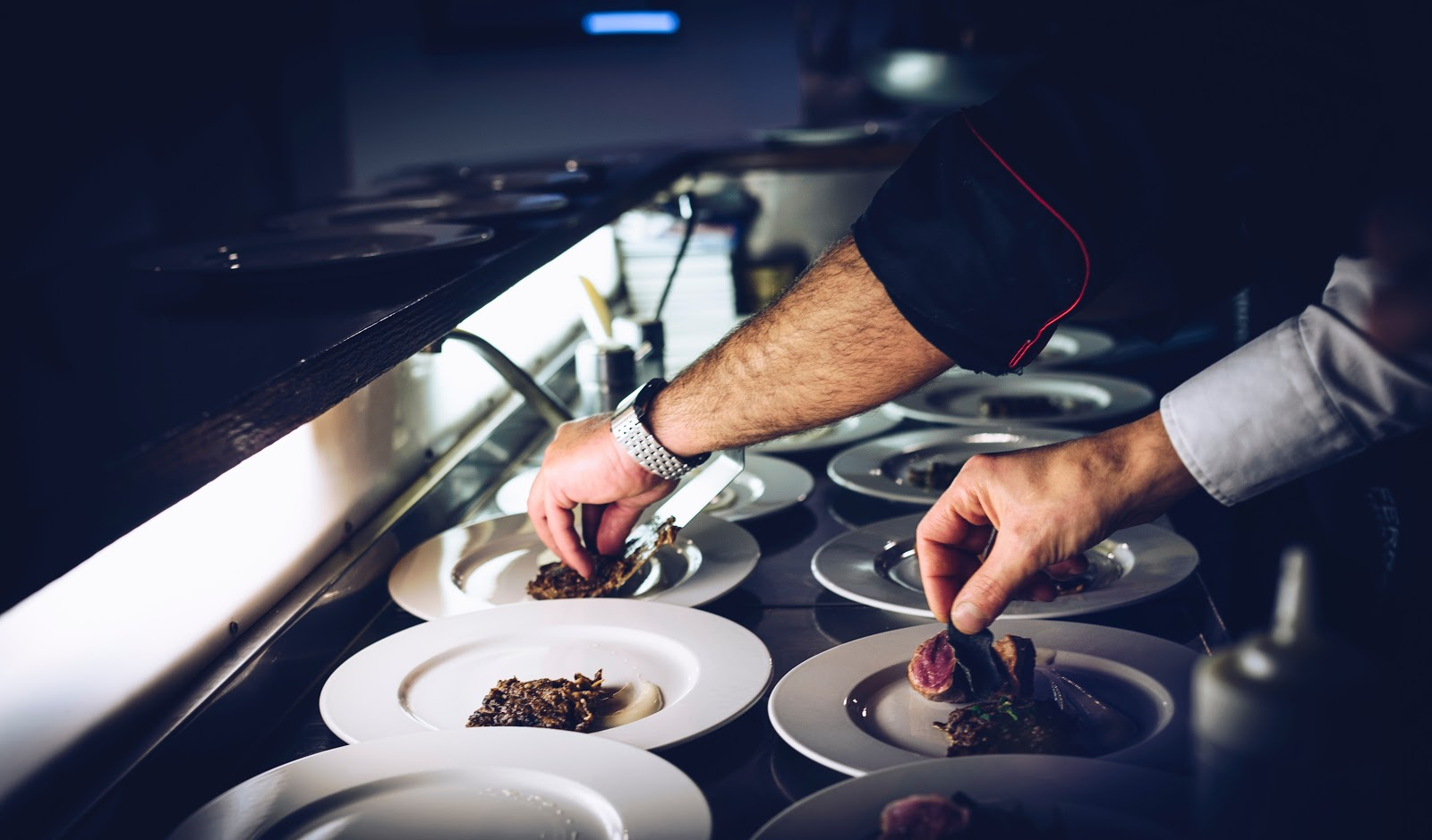 Used restaurant equipment: Chefs plating food