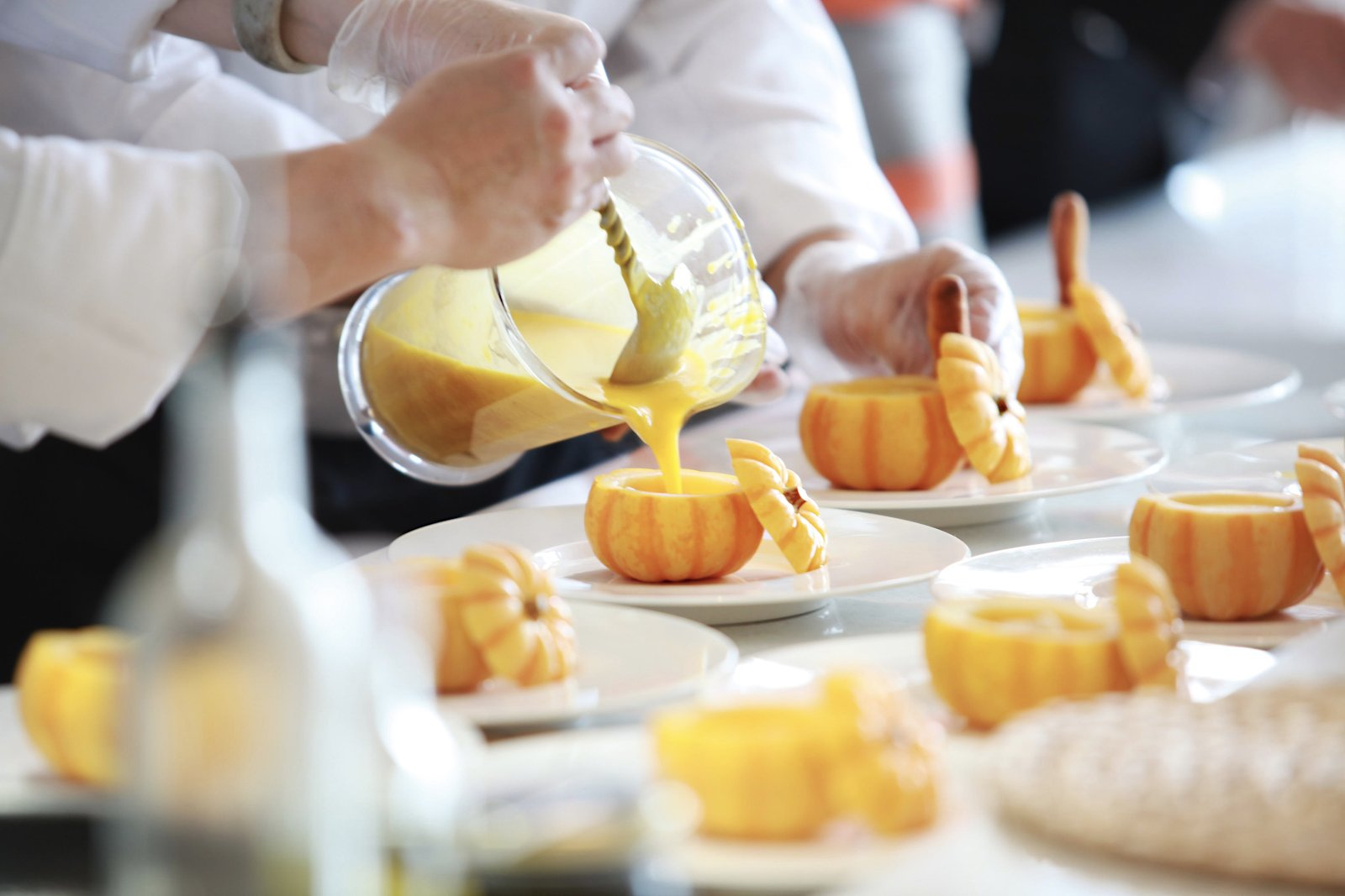Prep cook job description: Chef pours liquid into small pumpkin