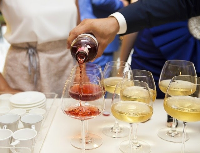 Restaurant schedule template: Server pouring wine into glass