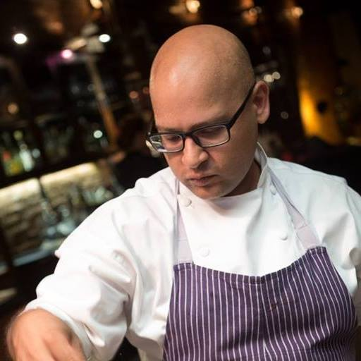 Zia preparing food back in his restaurant days.