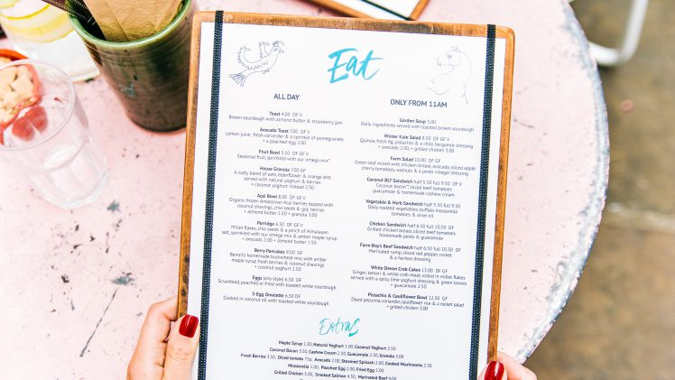 Person holding restaurant menu