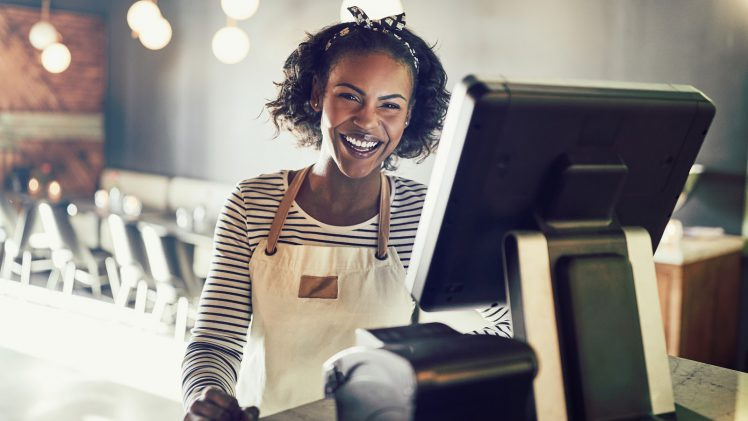 Internal promotion: Woman stands by cash register
